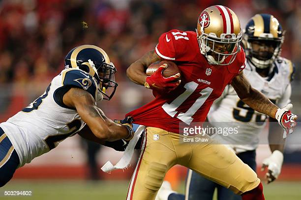 Quinton Patton of the San Francisco 49ers breaks a tackle during his 33yard pass play to setup the game winning field goal in overtime against the St...
