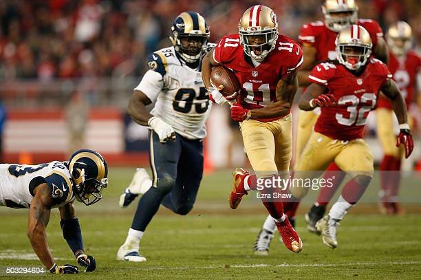 Quinton Patton of the San Francisco 49ers runs with the ball during his 33yard pass play to setup the game winning field goal in overtime against the...