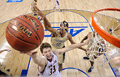 Quinton Stephens of the Georgia Tech Yellow Jackets defends a shot by Patrick Heckmann of the Boston College Eagles during a first round game of the...