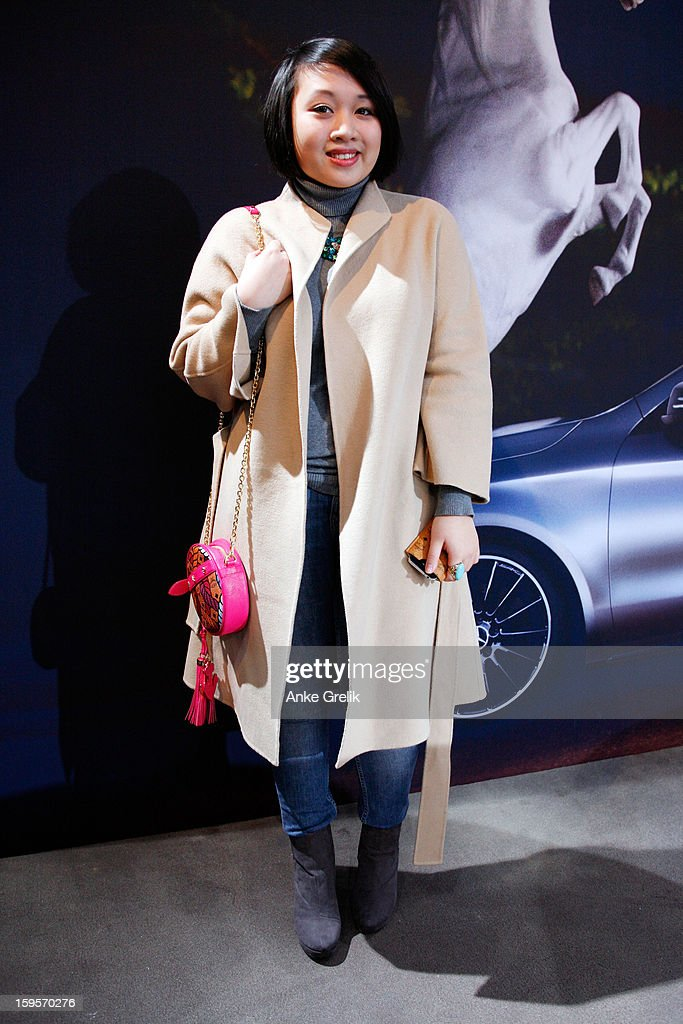 Quiny Nguyen wearing Jil Sander coat attends Mercedes-Benz Fashion Week Autumn/Winter 2013/14 at the Brandenburg Gate on January 16, 2013 in Berlin, Germany.