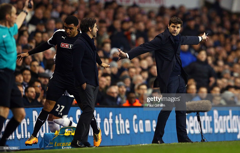 Quique Flores manager of Watford and <a gi-track='captionPersonalityLinkClicked' href=/galleries/search?phrase=Mauricio+Pochettino&family=editorial&specificpeople=234444 ng-click='$event.stopPropagation()'>Mauricio Pochettino</a> Manager of Tottenham Hotspur look on during the Barclays Premier League match between Tottenham Hotspur and Watford at White Hart Lane on February 6, 2016 in London, England.