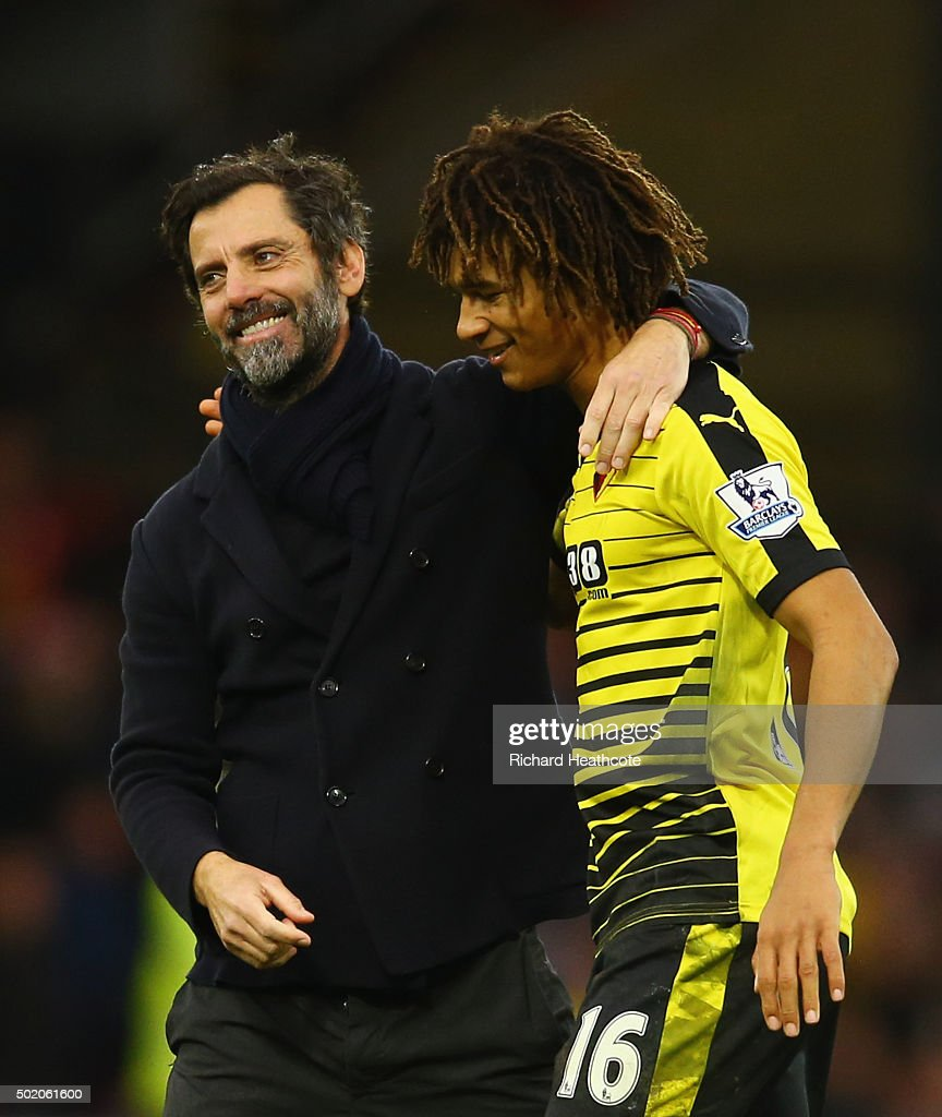 Quique Flores manager of Watford and Nathan Ake of Watford celebrate victory after the Barclays Premier League match between Watford and Liverpool at Vicarage Road on December 20, 2015 in Watford, England.
