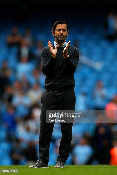 Quique Flores manager of Watford applauds fans after the Barclays Premier League match between Manchester City and Watford at Etihad Stadium on...