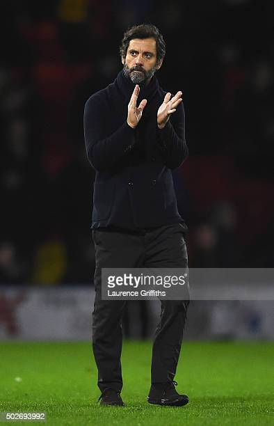 Quique Flores manager of Watford applauds fans after the Barclays Premier League match between Watford and Tottenham Hotspur at Vicarage Road on...