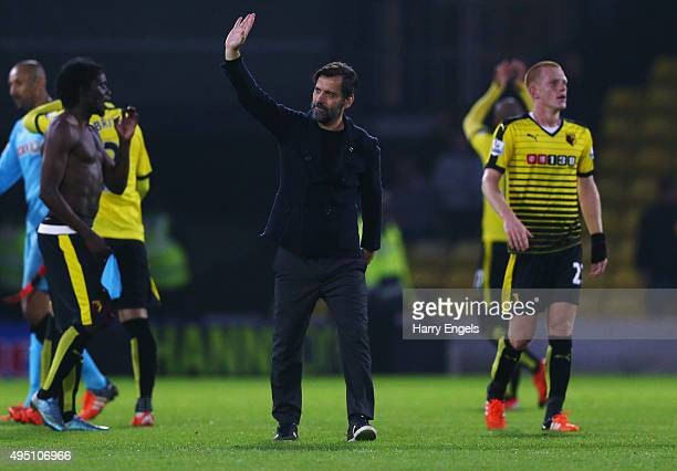 Quique Flores manager of Watford applauds supporters after his team's 20 win in the Barclays Premier League match between Watford and West Ham United...