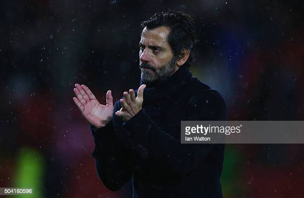 Quique Flores manager of Watford applauds the crowd after victory in the Emirates FA Cup Third Round match between Watford and Newcastle United at...