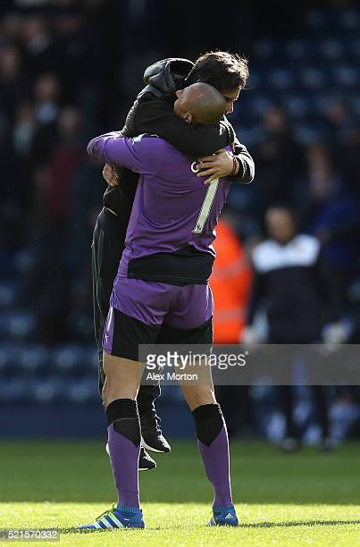 Quique Flores manager of Watford celebrates with Heurelho Gomes of Watford following his sides victory during the Barclays Premier League match...