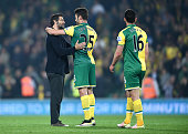 Quique Flores manager of Watford consoles Ivo Pinto of Norwich City after Norwich were relegated during the Barclays Premier League match between...