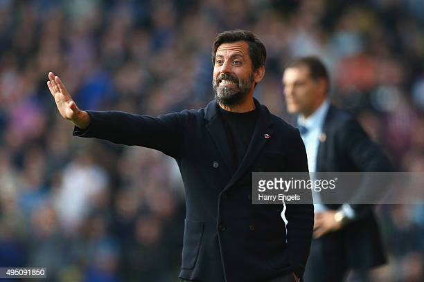 Quique Flores manager of Watford gestures during the Barclays Premier League match between Watford and West Ham United at Vicarage Road on October 31...