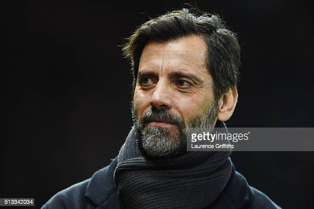 Quique Flores manager of Watford looks on during the Barclays Premier League match between Manchester United and Watford at Old Trafford on March 2...