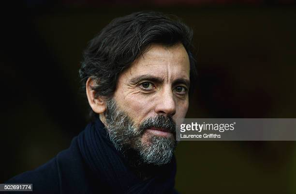 Quique Flores manager of Watford looks on prior to the Barclays Premier League match between Watford and Tottenham Hotspur at Vicarage Road on...