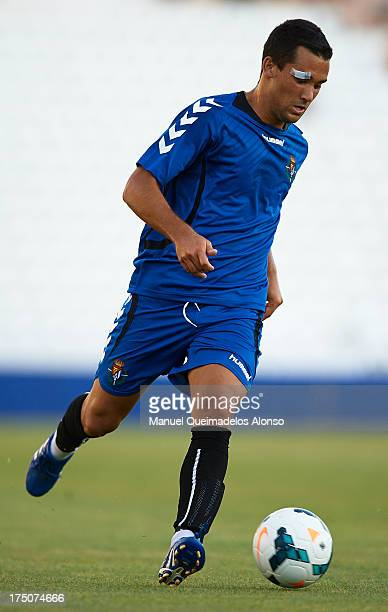 Quique Gonzalez of Valladolid runs with the ball during a friendly match between Abacete and Real Valladolid at Estadio Carlos Belmonte on July 30...
