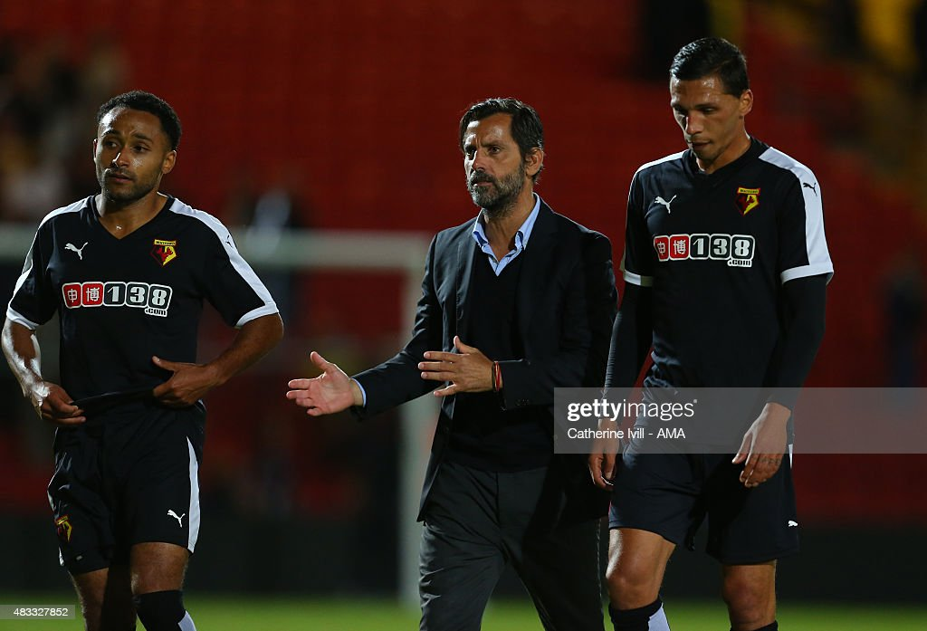Quique Sanchez Flores manager of Watford speaks with with Ikechi Anya and Jose Holebas of Watford after the pre-season friendly between Watford and Seville at Vicarage Road on July 31, 2015 in Watford, England.