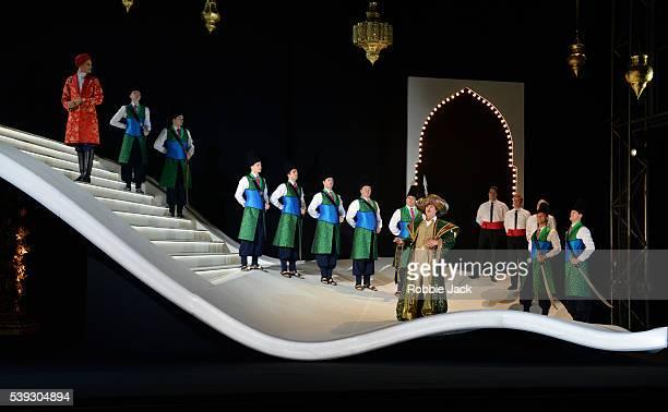 Quirijn de Lang as Mustafa and Riccardo Novaro as Taddeo with artists of the company in Garsington Opera's production of Gioachino Rossini's...