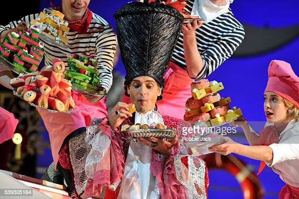 Quirijn de Lang as Mustafa with artists of the company in Garsington Opera's production of Gioachino Rossini's L'Italiana in Algeri directed by Will...