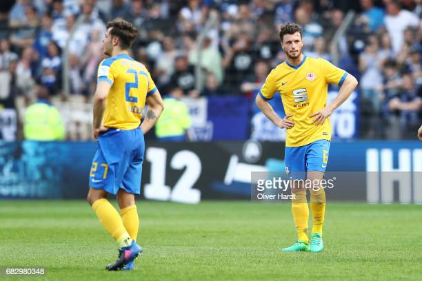 Quirin Moll and his team mates of Braunschweig appears frustrated after the Second Bundesliga match between DSC Arminia Bielefeld and Eintracht...