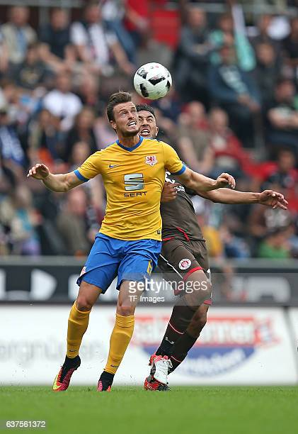 Quirin Moll of Braunschweig and Aziz Bouhaddouz of Pauli battle for the ball during the Second Bandesliga match between FC St Pauli and Eintracht...