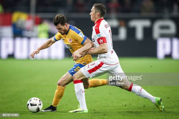 Quirin Moll of Braunschweig and Oliver Fink of Duesseldorf battle for the ball during the Second Bundesliga match between Fortuna Duesseldorf and...