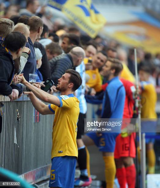 Quirin Moll of Braunschweig and team mates celebrate with fans after the Second Bundesliga match between TSV 1860 Muenchen and Eintracht Braunschweig...