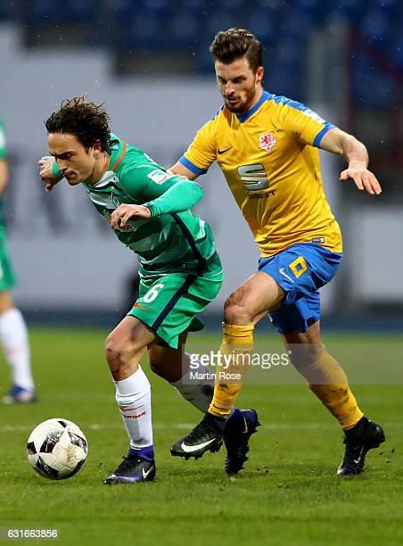 Quirin Moll of Braunschweig and Thomas Delaney of Bremen battle for the ball during the friendly match between Eintracht Braunschweig and Werder...