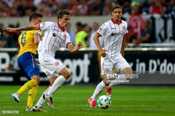 Quirin Moll of Braunschweig challenges Marcel Sobottka of Duesseldorf during the Second Bundesliga match between Fortuna Duesseldorf and Eintracht...