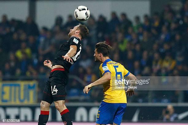 Quirin Moll of Braunschweig challenges Sebastian Jacob of Kaiserslautern during the Second Bundesliga match between Eintracht Braunschweig and 1 FC...