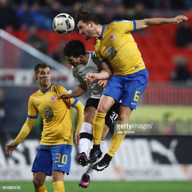 Quirin Moll of Braunschweig jumps for a header with Julian Derstroff of Sandhausen during the Second Bundesliga match between SV Sandhausen and...