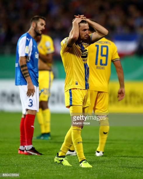 Quirin Moll of Braunschweig looks dejected after the DFB Cup first round match between Holstein Kiel and Eintracht Braunschweig at HolsteinStadion on...