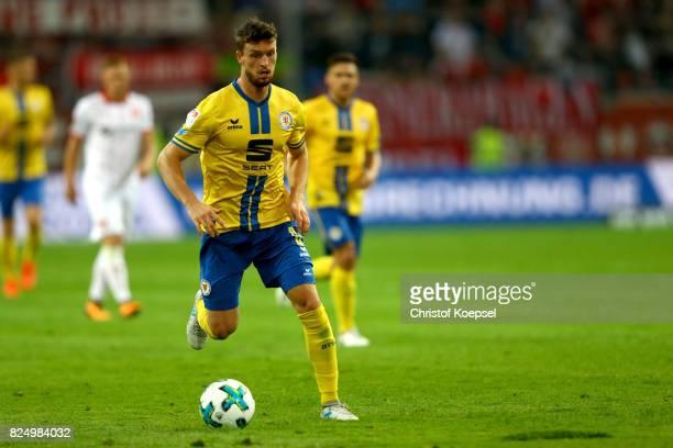 Quirin Moll of Braunschweig runs with the ball during the Second Bundesliga match between Fortuna Duesseldorf and Eintracht Braunschweig at...
