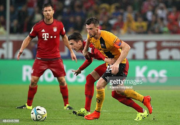 Quirin Moll of Dresden challenges Lucas Scholl of Bayern Muenchen during the friendly match between SG Dynamo Dresden and FC Bayern Muenchen at...