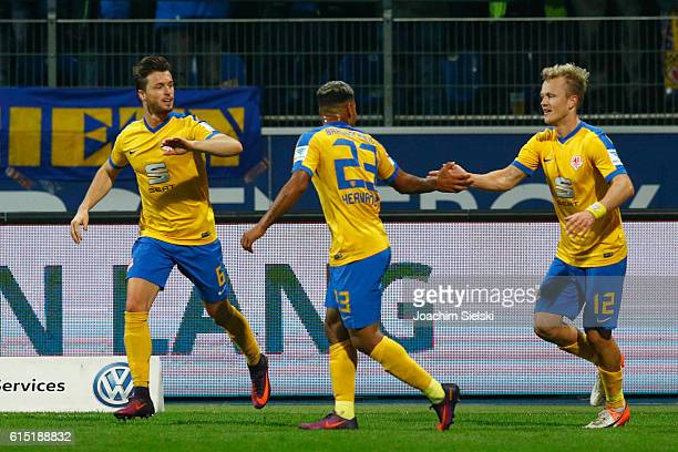 Quirin Moll Onel Hernandez and Nik Omladic of Braunschweig celebration the Goal 10 for Braunschweig during the Second Bundesliga match between...