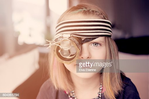 Quirky girl wearing steampunk eye monocle