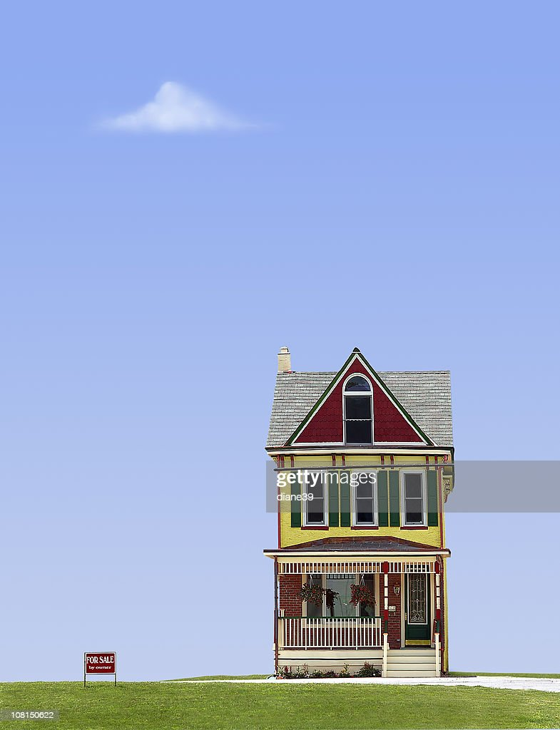 Quirky House with For Sale Against Blue Sky : Stock Photo