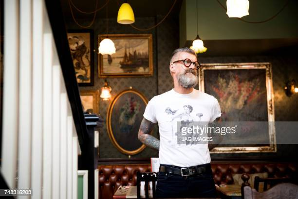Quirky man in bar and restaurant, Bournemouth, England
