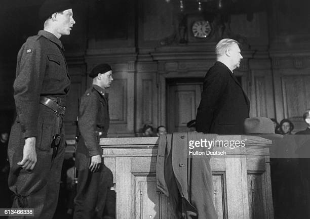 Quisling On Trial For His Life Palefaced and with his thinning hair combed in a style reminiscent of Hitler Vidkin Quisling began the legal battle...