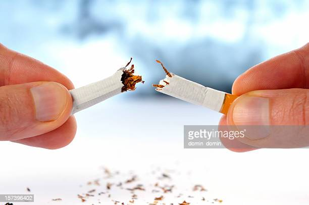 Quit smoking, cigarette broken in half, isolated white, x-ray background