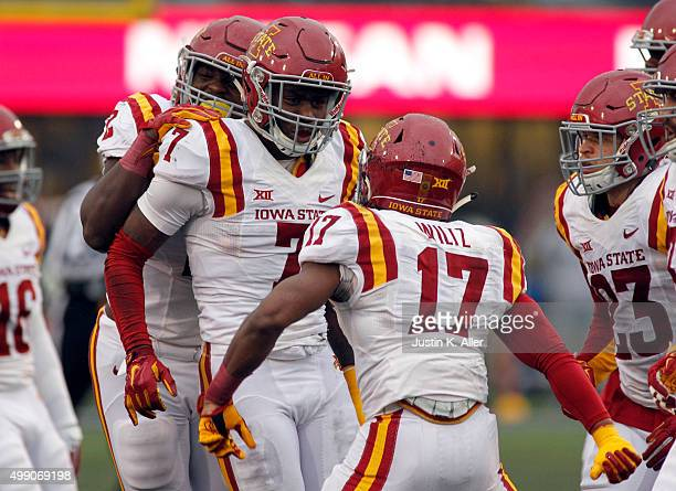 Qujuan Floyd of the Iowa State Cyclones celebrates with teammates after catching an interception during the game on November 28 2015 at Mountaineer...