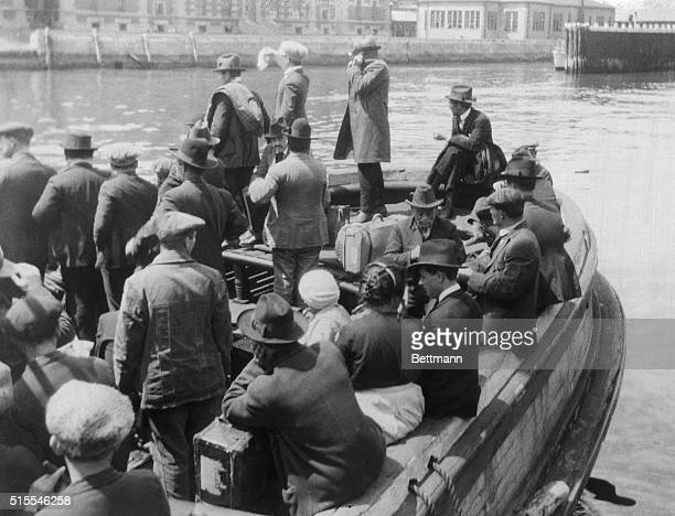 Quota law sends them back to native landsNew Yorkwaving a sad fare well to friends on the dock at Ellis island these wouldbe immigrants rejected...