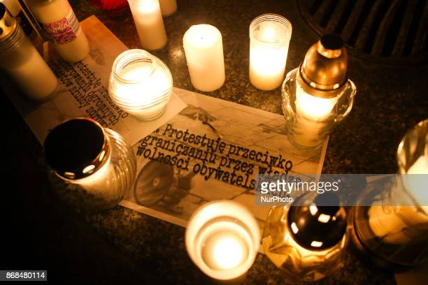 A quotation of Piotr S says 'I protest against government limiting civil rights' People gathered at the Main Square in Krakow to light candles for a...