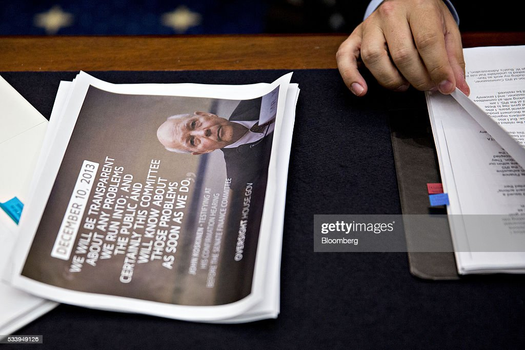 A quote and photograph of International Revenue Service (IRS) Commissioner John Koskinen sits next to Representative Ron DeSantis, a Republican from Florida, before the start of a House Judiciary Committee hearing in Washington, D.C., U.S., on Tuesday, May 24, 2016. The hearing is part of some Republican lawmakers' push to impeach Koskinen for allegedly failing to cooperate with an investigation after the IRS reportedly targeted conservative groups applying for tax-exempt status
