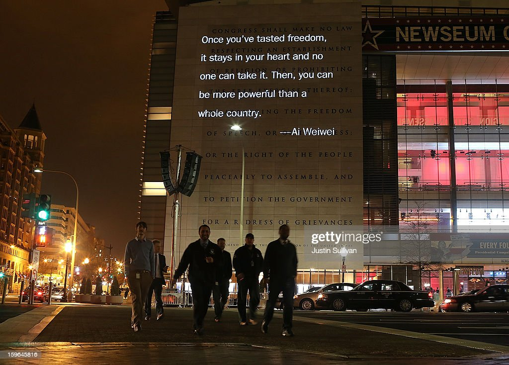 A quote by Chinese artist and activist Ai Weiwei is seen projected on a 74-foot-tall marble First Amendment tablet on the exterior of the Newseum on January 17, 2013 in Washington, DC. The exhibit runs 7 p.m. each night through January 17.