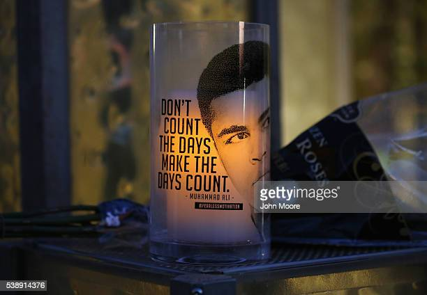 A quote from Muhammad Ali adorns a makeshift memorial at the Muhammad Ali Center on June 8 2016 in Louisville Kentucky A funeral procession and...