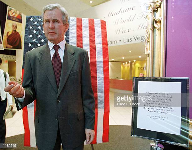 A quote from President George W Bush's speech about the terrorist attacks on America are posted next to the wax likeness of the US leader September...