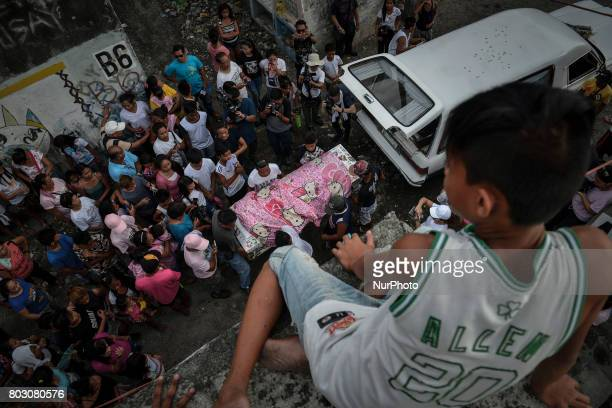 A quotHello Kittyquot blanket covers the coffin of sixteen year old Nercy Galicio who according to police was raped and killed by unknown men after...