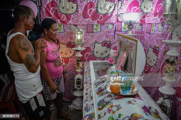 quotHello Kittyquot decorations adorn the coffin of sixteen year old Nercy Galicio who according to police was raped and killed by unknown men after...