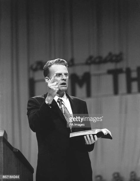 Quoting from the Bible he is holding BILLY GRAHAM the American evangelist addresses the congregation at his AllBritain crusade dedication service in...