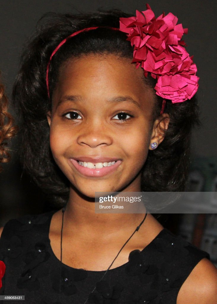 Quvenzhané Wallis poses backstage at 'Annie' on Broadway at The Palace Theater on December 22 2013 in New York City