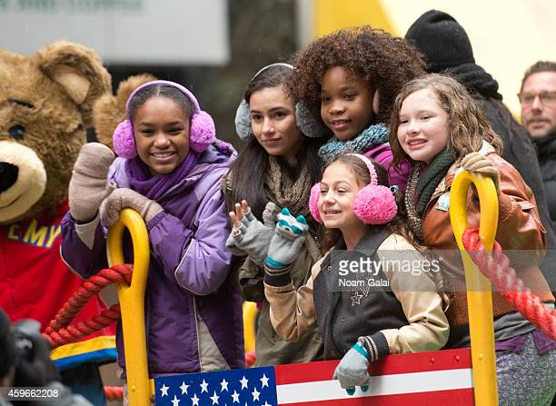 Quvenzhane Wallis and the cast of 'Annie' attend the 88th Annual Macys Thanksgiving Day Parade at on November 27 2014 in New York New York