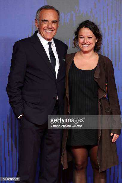 Ra Di Martino and Festival director Alberto Barbera walk the red carpet ahead of the 'Controfigura' screening during the 74th Venice Film Festival at...