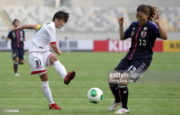 Ra UmSim of North Korea competes for the ball with Rumi Utsugi during the EAFF Women's East Asian Cup match between Japan and Korea DPR at Hwaseong...